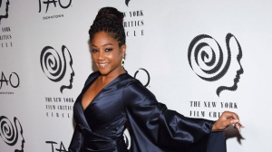 "Best supporting actress winner for ""Girls Trip"" Tiffany Haddish attends the New York Film Critics Circle Awards at TAO Downtown on Wednesday, Jan. 3, 2018, in New York. (Photo by Evan Agostini/Invision/AP)"