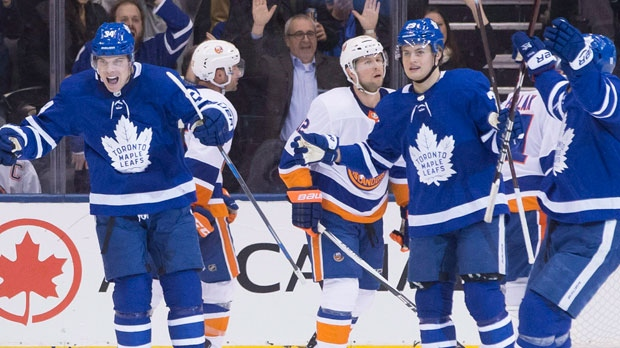 Toronto Maple Leafs' Auston Matthews (left) celebrates after scoring against the New York Islanders during third period NHL hockey action in Toronto, on Thursday, February 22, 2018.THE CANADIAN PRESS/Chris Young