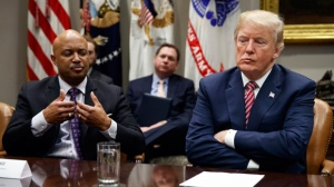 President Donald Trump listens as Indiana Attorney General Curtis Hill speaks during a meeting with state and local officials to discuss school safety in the Roosevelt Room of the White House, Thursday, Feb. 22, 2018, in Washington. (AP Photo/Evan Vucci)