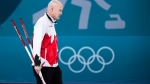Kevin Koe of Canada looks on while playing against Switzerland during men's bronze medal curling finals at the 2018 Olympic Winter Games in Gangneung, South Korea on Friday, February 23, 2018. Switzerland defeated Canada to win the bronze medal. THE CANADIAN PRESS/Nathan Denette