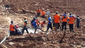 Rescuers search for victims at the site of a landslide in Brebes, Central Java, Indonesia, Friday, Feb. 23, 2018. Farmers were working in their rice paddies on the main island of Java, when the soggy hillside above them collapsed under the weight of torrential rains, killing a number people and leaving rescuers digging for more than a dozen missing. (AP Photo)