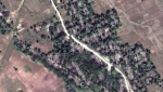 This Dec. 20, 2017, satellite image provided by DigitalGlobe, shows the village of Myin Hlut, 25 kilometers (15 miles) southeast of Maungdaw, Rakhine state, Myanmar. Satellite images of Myanmar's troubled Rakhine state, released to The Associated Press by Colorado-based DigitalGlobe on Friday, Feb. 23, 2018, show that dozens of empty villages and hamlets have been completely leveled by authorities in recent weeks, far more than previously reported. The villages were all set ablaze in the wake of violence last August, when a brutal clearance operation by security forces drove hundreds of thousands of Rohingya into exile in Bangladesh. (DigitalGlobe via AP)