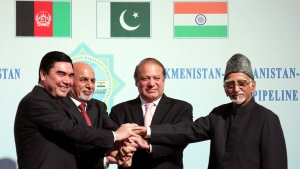 In this Sunday, Dec. 13, 2015 photo, Turkmen President Gurbanguly Berdymukhamedov, left, shakes hands with Afghan President Ashraf Ghani, second left, Pakistani Prime Minister Mohammad Nawaz Sharif, second right, and Indian Vice President Hamid Ansari during a ceremony in Ashgabat, Turkmenistan. The three leaders have joined the president of Turkmenistan in breaking ground on a new pipeline intended to deliver natural gas from the energy-rich former Soviet republic to their three countries. The 1,800-kilometer (1,080-mile) TAPI pipeline is intended to carry gas through the Afghan cities of Herat and Kandahar and end up in the India-Pakistan border town of Fazilka. (AP Photo/Alexander Vershinin)