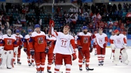Russian athlete Kirill Kaprizov (77) celebrates after the semifinal round of the men's hockey game against the Czech Republic at the 2018 Winter Olympics in Gangneung, South Korea, Friday, Feb. 23, 2018. Olympic Athletes from Russia won 3-0. (AP Photo/Matt Slocum)