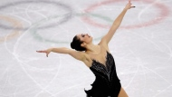 Kaetlyn Osmond of Canada performs during the women's free figure skating final in the Gangneung Ice Arena at the 2018 Winter Olympics in Gangneung, South Korea, Friday, Feb. 23, 2018. (AP Photo/Petr David Josek)