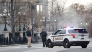 Police block 17th Street near the White House in Washington after a vehicle rammed into a security barrier near the White House, Friday, Feb. 23, 2018, in Washington. (AP Photo/Pablo Martinez Monsivais)