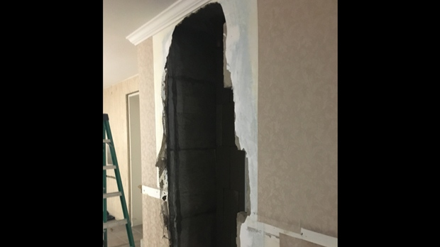 A recent picture obtained by CP24 shows a hallway inside Bruce McArthur's Thorncliffe Park Drive home. Det. Sgt. Hank Idsinga said forensics officers removed a section of wall from the hallway to inspect pipes beneath the wall.