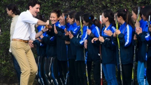 Prime Minister Justin Trudeau takes part in a hockey event with Hayley Wickenheiser and the Indian women's national ice hockey team at the Canadian High Commission of Canada in New Delhi, India on Saturday, Feb. 24, 2018. THE CANADIAN PRESS/Sean Kilpatrick