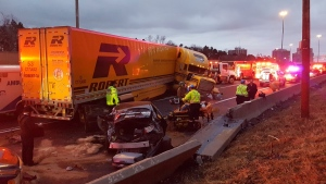 Vehicles involved in a collision in the WB collector lanes on Hwy. 401 are shown on Saturday morning. Three people were taken to hospital with minor injuries following the crash. (Peter Mills)