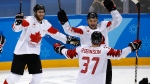 Wojtek Wolski (8), of Canada, celebrates a goal against the Czech Republic with his teammates during the third period of the men's bronze medal hockey game at the 2018 Winter Olympics in Gangneung, South Korea, Saturday, Feb. 24, 2018. (AP Photo/Charlie Riedel)