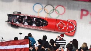 Canada driver Justin Kripps, Jesse Lumsden, Alexander Kopacz and Oluseyi Smith race during heat three of the four-man bobsled final at the Pyeongchang 2018 Winter Olympic Games in South Korea, Sunday, Feb. 25, 2018. THE CANADIAN PRESS/Jonathan Hayward