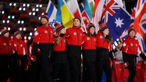 Canadian athletes walk into the stadium during the closing ceremony of the 2018 Winter Olympics in Pyeongchang, South Korea, Sunday, Feb. 25, 2018. (AP Photo/Kirsty Wigglesworth)