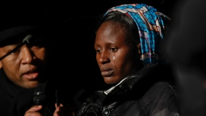 Rebecca Bitrus, a Nigerian victim of Boko Haram, attends a ceremony where the Colosseum was lit up in red to draw attention to the persecution of Christians around the world, in Rome, Saturday, Feb. 24, 2018. (AP Photo/Alessandra Tarantino)
