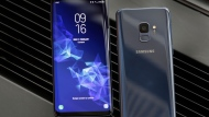 This Wednesday, Feb. 21, 2018, photo shows the Samsung Galaxy S9 Plus, left, and back of a Galaxy S9 mobile phone, during a product preview in New York. (AP Photo/Richard Drew)
