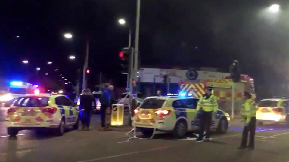 In this image taken from video made available by Gem News, police attend the scene of an incident in Leicester, central England, Sunday Feb. 25, 2018. (Gem News via AP)