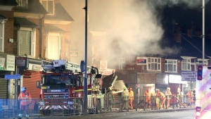 Emergency personnel attend the scene of an incident in Leicester, central England, Sunday Feb. 25, 2018. (Aaron Chown/PA via AP)