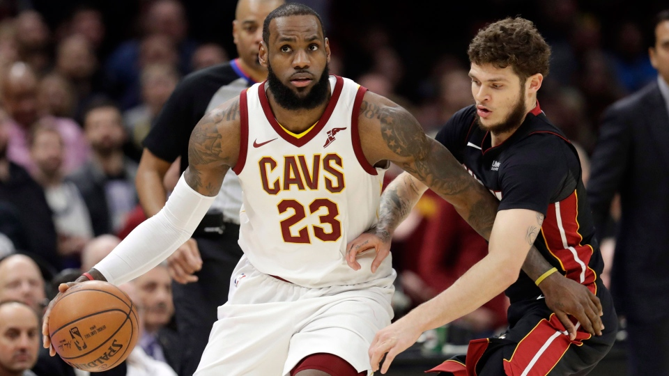 In this Wednesday, Jan. 31, 2018 file photo, Cleveland Cavaliers' LeBron James, left, drives past Miami Heat's Tyler Johnson in the second half of an NBA basketball game in Cleveland.  (AP Photo/Tony Dejak, File)