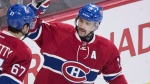 Montreal Canadiens' captain Max Pacioretty (67) celebrates with teammate Tomas Plekanec after scoring on the Ottawa Senators during first period NHL hockey action, in Montreal, on Saturday, Dec. 12, 2015. THE CANADIAN PRESS/Graham Hughes