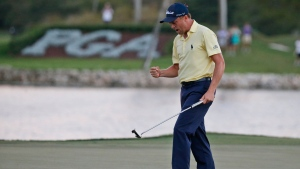 Justin Thomas celebrates after winning the Honda Classic golf tournament in a sudden-death playoff, Sunday, Feb. 25, 2018 in Palm Beach Gardens, Fla. (AP Photo/Wilfredo Lee)