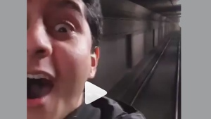 A man appears to ride the outside of a subway car in a video posted to Instagram Monday February 26, 2018. (6ixbuzztv /Instagram)