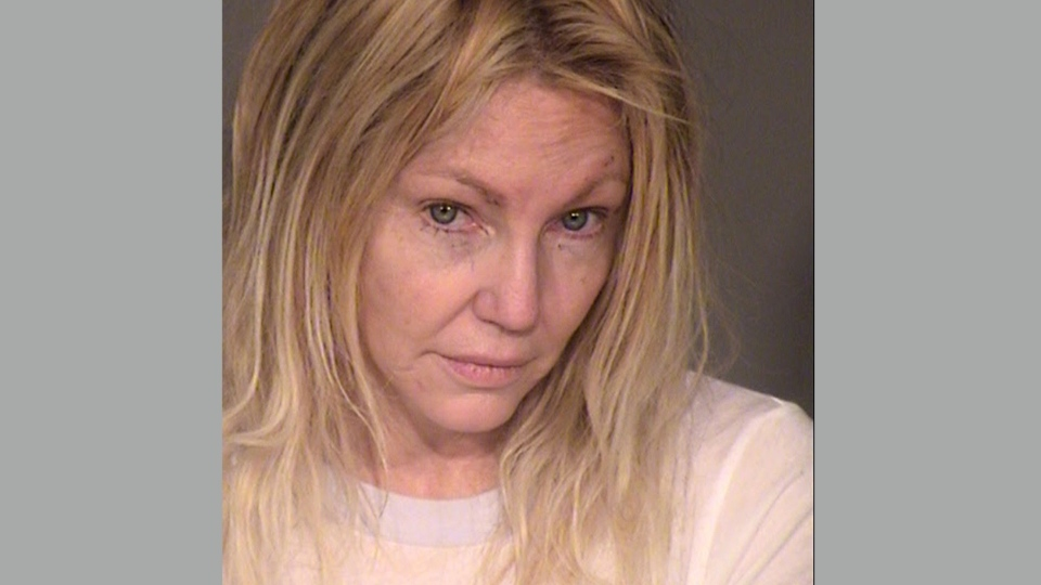 This undated booking photo provided by the Ventura County Sheriff's Office shows actress Heather Locklear. Locklear was arrested for investigation of domestic violence and fighting with sheriff's deputies at her California home, authorities said Monday, Feb. 26, 2018. (Ventura County Sheriff's Office via AP)