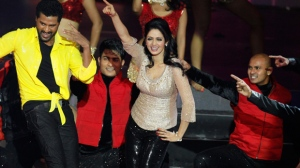 This July 6, 2013 file photo shows Bollywood actors Sridevi, center, and Prabhu Deva, left in yellow, performing during the International Indian Film Academy (IIFA) awards in Macau. Sridevi, Bollywood's leading lady of the 1980s and 90s who redefined stardom for actresses in India, has died at age 54. The actress, known by one name, was described as the first female superstar in India's male-dominated film industry. Her brother-in-law Sanjay Kapoor speaking to the Indian Express online confirmed she died Saturday, Feb. 24, 2018, in Dubai due to cardiac arrest.  (AP Photo/Kin Cheung, File)