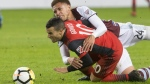 Colorado Rapids' Kortne Ford (left) wrestles Toronto FC's Sebastian Giovinco to the ground during second half CONCACAF Champions League Round of 16 action in Toronto on Tuesday, February 27, 2018. THE CANADIAN PRESS/Chris Young