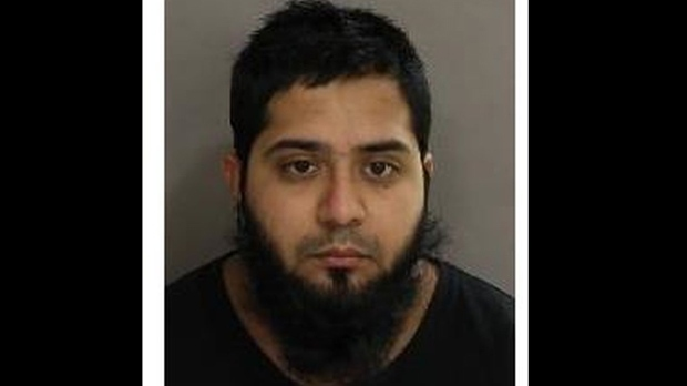 Saleh Momla, 24, is shown in a handout image from Toronto police.
