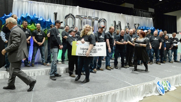 Thirty-one instant millionaires: NL co-workers presented with $60M cheque