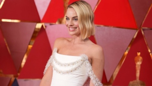 Margot Robbie arrives at the Oscars on Sunday, March 4, 2018, at the Dolby Theatre in Los Angeles. (Photo by Richard Shotwell/Invision/AP)