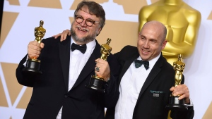 "Guillermo del Toro, left, winner of the awards for best director for ""The Shape of Water"" and best picture for ""The Shape of Water"", and J. Miles Dale, winner of the award for best picture for ""The Shape of Water"", pose in the press room at the Oscars on Sunday, March 4, 2018, at the Dolby Theatre in Los Angeles. (Photo by Jordan Strauss/Invision/AP)"