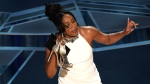 Tiffany Haddish presents the award for best documentary short subject at the Oscars on Sunday, March 4, 2018, at the Dolby Theatre in Los Angeles. (Photo by Chris Pizzello/Invision/AP)
