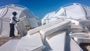 """This photo provided by Jake Strang shows mattress and tents set up for attendees of the Fyre Festival, Friday, April 28, 2017 in the Exuma islands, Bahamas. Organizers of the much-hyped music festival in the Bahamas canceled the weekend event at the last minute Friday after many people had already arrived and spent thousands of dollars on tickets and travel. A statement cited """"circumstances out of our control,"""" for their inability to prepare the """"physical infrastructure"""" for the event in the largely undeveloped Exumas. (Jake Strang via AP)"""
