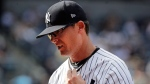 New York Yankees relief pitcher Tyler Clippard leaves the field in the middle of the ninth inning of a baseball game against the Texas Rangers, Saturday, June 24, 2017, in New York. (AP Photo/Frank Franklin II)