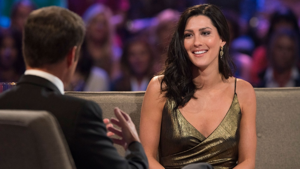 "This image released by ABC shows host Chris Harrington, left, with Becca Kufrin on ""The Bachelor: After the Final Rose."" (Paul Hebert/ABC via AP)"