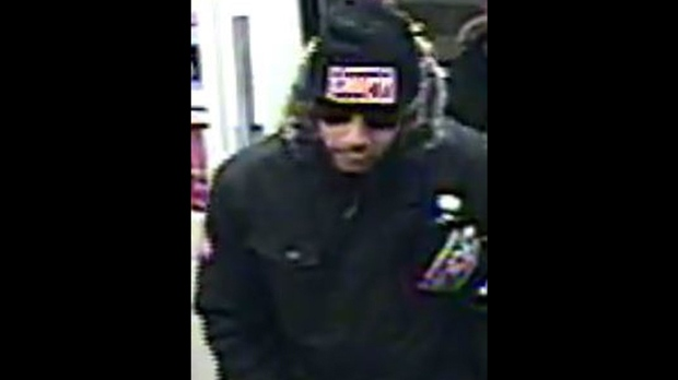 A man wanted in relation to a stabbing investigation is shown in a surveillance camera image. (TPS)