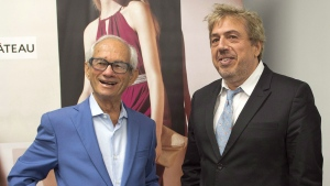 Le Chateau founder and Director Herschel Segal, left, chats with Franco Rocchi, senior vice-president of sales and operations after the company's annual meeting Wednesday, July 15, 2015 in Montreal. THE CANADIAN PRESS/Ryan Remiorz