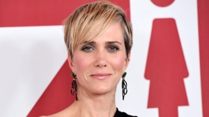 "In this Dec. 18, 2017 file photo, Kristen Wiig, a cast member in ""Downsizing,"" poses at a special screening of the film in Los Angeles. Wiig will play a villain in the next ""Wonder Woman"" film. Director Patty Jenkins announced on Twitter Friday that Wiig will star as Wonder Woman rival Cheetah in the superhero sequel. (Photo by Chris Pizzello/Invision/AP, File)"