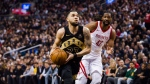 Toronto Raptors guard Fred VanVleet (23) drives to the net past Houston Rockets centre Nene Hilario (42) during first half NBA basketball action in Toronto on Friday, March 9, 2018. THE CANADIAN PRESS/Christopher Katsarov