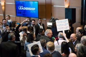 Candidate Doug Ford makes his way past journalists and attendees to listen to introductory speeches at the Ontario Progressive Leadership announcement in Markham, Ont. on Saturday, March 10, 2018. THE CANADIAN PRESS/Chris Young