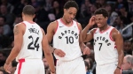 Toronto Raptors guard DeMar DeRozan (10), forward Norman Powell (24) and guard Kyle Lowry (7) react during the final minutes of the second half of an NBA basketball game, Sunday, March 11, 2018, at Madison Square Garden in New York. The Raptors won 132-106. (AP Photo/Mary Altaffer)