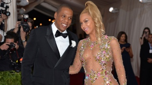 """In this May 4, 2015, file photo, Jay Z, left, and Beyonce arrive at The Metropolitan Museum of Art's Costume Institute benefit gala celebrating """"China: Through the Looking Glass"""" in New York. (Photo by Evan Agostini/Invision/AP, File)"""