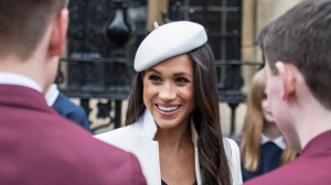 Meghan Markle meets well-wishers in the Dean's yard, after the Commonwealth Service at Westminster Abbey in London, Monday, March 12, 2018. Organised by The Royal Commonwealth Society, the Commonwealth Service is the largest annual inter-faith gathering in the United Kingdom. (Jack Hill/Pool Photo via AP)