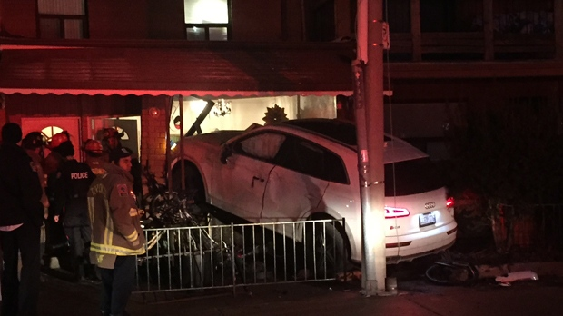 Police are searching for the occupants of an SUV that crashed into a home in Little Italy overnight. (Michael Nguyen/ CP24)