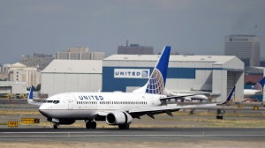 In this Sept. 9, 2015, file photo, a United Airlines jet lands at Newark Liberty International Airport in Newark, N.J. United Continental Holdings, Inc. reports earnings, Tuesday, Jan. 23, 2018. (AP Photo/Mel Evans, file)