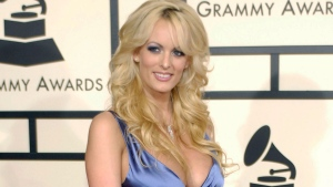 In this Feb. 10, 2008 file photo, adult film star Stormy Daniels arrives at the 50th Annual Grammy Awards in Los Angeles. (AP Photo/Chris Pizzello, File)