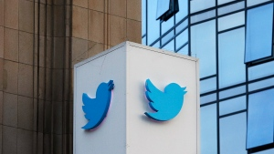 This Oct. 26, 2016 file photo shows a Twitter sign outside of the company's headquarters in San Francisco. (AP Photo/Jeff Chiu, File)