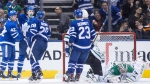 Toronto Maple Leafs left wing James van Riemsdyk, second from left, celebrates with centre Tyler Bozak (42) right wing Connor Brown (28) and defenceman Travis Dermott (23) after scoring against Dallas Stars goaltender Kari Lehtonen (32) during third period NHL hockey action in Toronto on Wednesday, March 14, 2018. THE CANADIAN PRESS/Chris Young