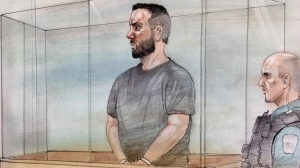 Twenty-nine-year-old Cory Fenn appears in an Oshawa courtroom on March 15, 2018. Fenn has been charged in connection with the deaths of three members of an Ajax family.