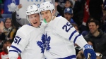 Toronto Maple Leafs' Jake Gardiner (51) and James Van Riemsdyk (25) celebrate a goal during the first period of an NHL hockey game against the Buffalo Sabres, Thursday, March 15, 2018, in Buffalo, N.Y. (AP Photo/Jeffrey T. Barnes)